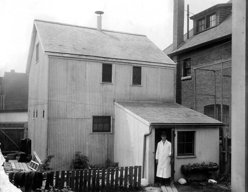 """William """"Billy"""" Fenton at the door of the Barton Avenue Stable at 145 Barton Ave., Toronto, in 1914."""