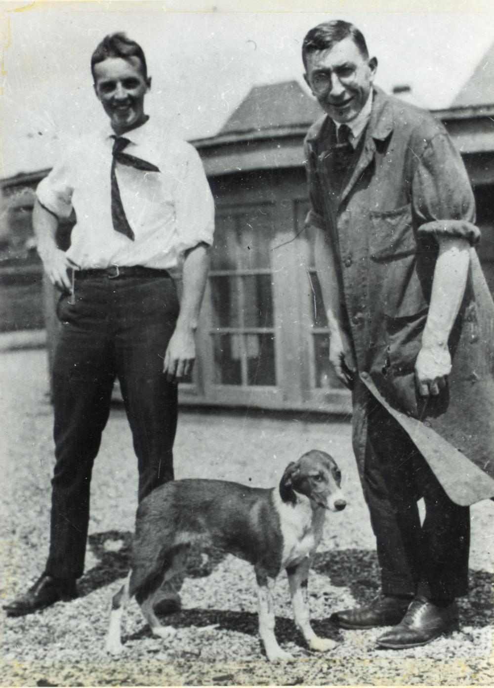 Iconic photo likely taken in the summer of 1921 of Dr. Frederick Banting (right) and Charles Best on the roof of the U of T Medical Building, with one of the dogs that helped show that pancreatic extract could control blood sugar levels.