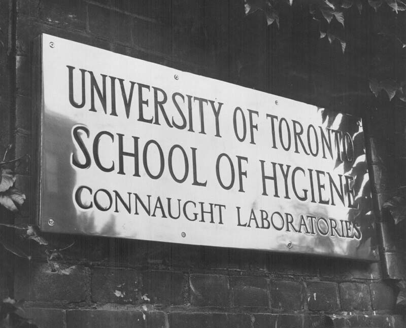 Brass plate sign for the University of Toronto School of Hygiene and Connaught Laboratories, installed at the main entrance of the School of Hygiene Building.