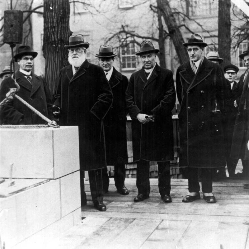 Cornerstone dedication of the School of Hygiene Building in the fall of 1926. Attending were, left to right, A.E. Gooderham, Chair of the U of T Connaught Committee; William Mulock, Chancellor of U of T; Robert Falconer, President of U of T; H.J. Cody, Chairman, U of T Board of Governors; and Dr. J.G. FitzGerald.