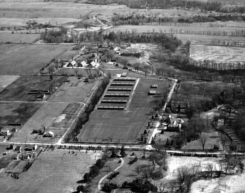 Aerial photo of the Connaught Labs Farm site on Steeles Avenue West, just east of Dufferin Street, taken in the mid-1940s. At the centre of the photos are the 6 horse stables built to accommodate the 300 horses needed to prepare the Canadian military's initial order of 150,000 doses of gas-gangrene antitoxin.