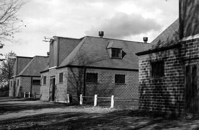 "Two red brick horse stables were built at the Connaught Laboratories ""Farm"" site in 1935 and a third was added in 1940; they were later known as Buildings 22, 23 and 28 and demolished around the year 2000."
