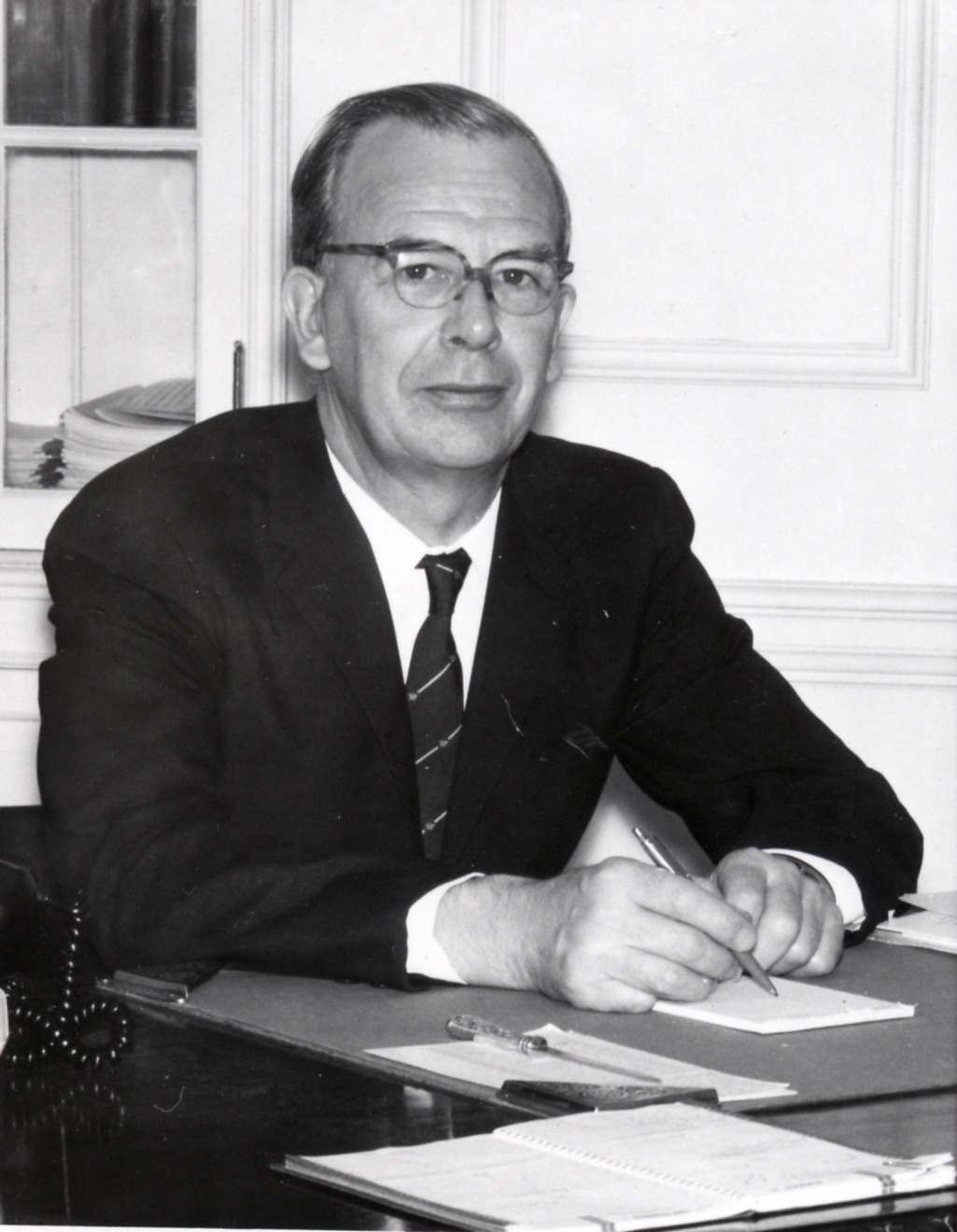 Dr. Andrew James Rhodes at his desk, c. 1950s.