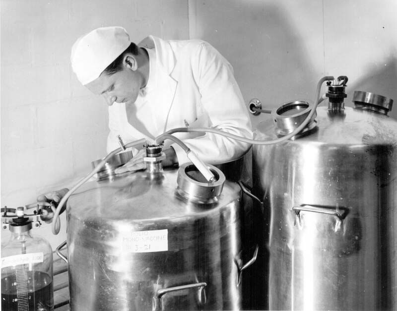 In this photo, taken in 1957, Paul Budrevicious is shown overseeing the inactivation of poliovirus fluids to prepare Salk inactivated polio vaccine at Connaught. An archival film produced by Connaught in 1958, illustrating the Salk polio vaccine production process, is available at: http://www.museumofhealthcare.ca/explore/exhibits/vaccinations/polio.html#conqueringthecrippler