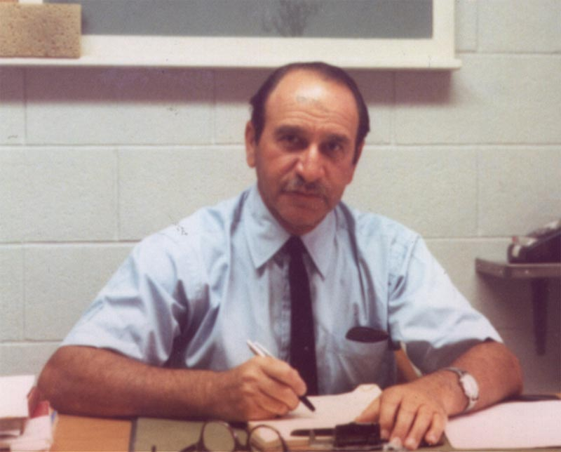 Photo of Dr. Paul Fenje at his desk.