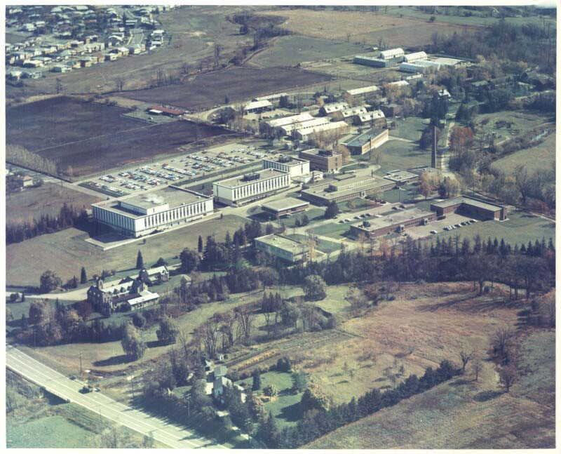 Connaught Medical Research Laboratories' Dufferin Division on Steeles Avenue West, just east of Dufferin Street, as seen from the air in 1967 and looking from the north-west to the south-east. During the mid-1960s the Labs underwent a major building boom, the most apparent being three large white buildings in the centre of the photo which accommodated the Lab's Administration, Filling and Packaging, and Regulatory Affairs facilities, enabling their move from the main University of Toronto campus.