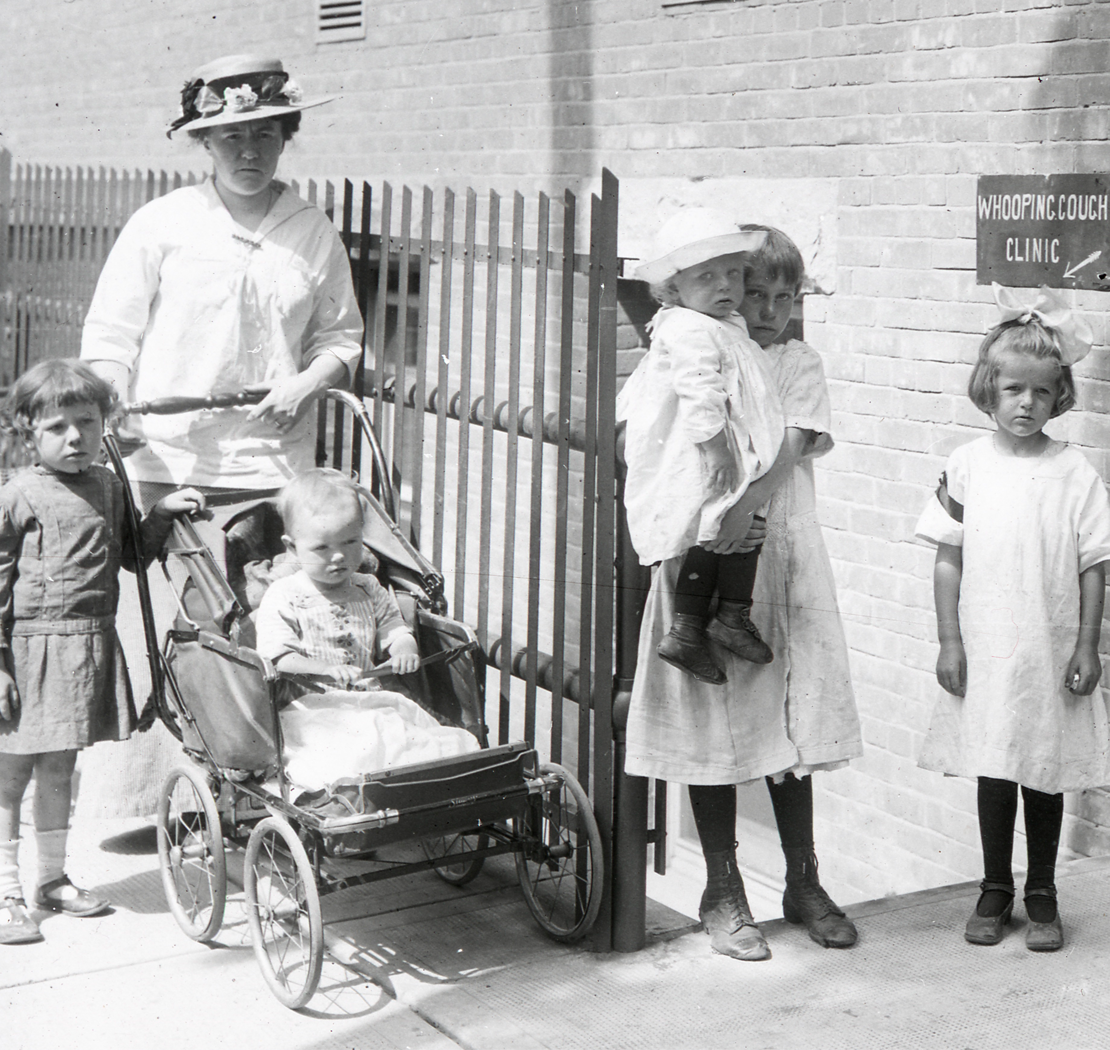 "Parents and children outside the ""Whooping Cough Clinic"" at the Hospital for Sick Children in Toronto, c. 1930s."
