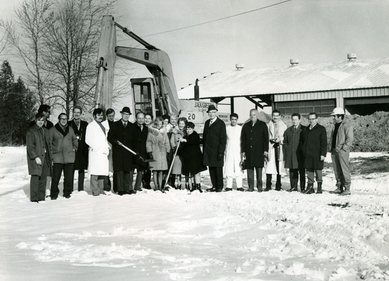 Official sod-tuning ceremony to start construction of Building 90, December 1971. Dr. J.M. Corkill, the tall man at the centre of the photo, spearheaded the design and development of the building.